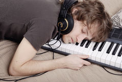Man asleep on the MIDI-keyboard Royalty Free Stock Image