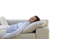 Man asleep on sofa, cut out Royalty Free Stock Images
