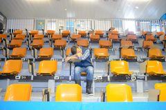 Man asleep in stands. Male stock images