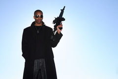 Man with assault rifle. A young man holding an assault rifle Royalty Free Stock Image