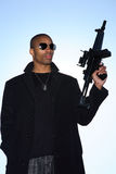 Man with assault rifle. A young man holding an assault rifle royalty free stock photos
