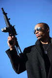 Man with assault rifle. A young man holding an assault rifle Royalty Free Stock Photo