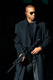 Man with assault rifle. A young man holding an assault rifle Stock Photos