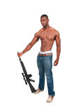 Man with Assault Rifle. Handsome man holding an automatic assault rifle royalty free stock image