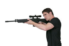 Man with Assault Rifle. Handsome man holding an automatic assault rifle Royalty Free Stock Images