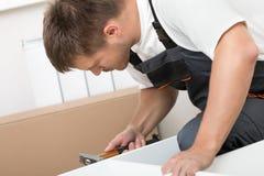 Man assembing furniture Stock Photography