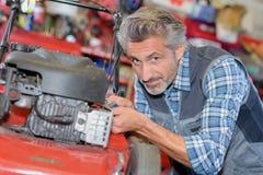 Man assemble brush cutter engine Stock Photos