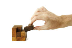 Man assemble wooden cube puzzle isolated Royalty Free Stock Photo
