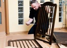 Man assembles a baby crib Stock Photo