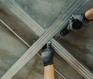 Man assembles profile metal frame Stock Images