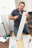 Man Assembling Flat Pack Furniture Royalty Free Stock Image
