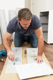 Man Assembling Flat Pack Furniture Stock Photos