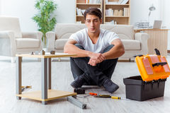 The man assembling furniture at home Stock Photos