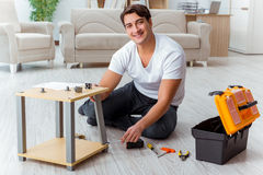 The man assembling furniture at home Royalty Free Stock Images