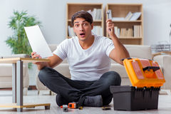 The man assembling furniture at home Royalty Free Stock Image