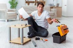 The man assembling furniture at home Stock Photos