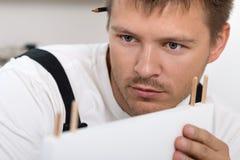 Man Assembling Furniture Stock Photo