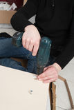 Man assembling a shelf Stock Photography
