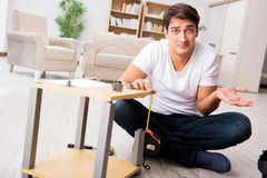 The man assembling shelf at home Royalty Free Stock Image