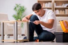 The man assembling shelf at home Stock Photo