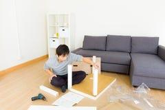 Man assembling table Stock Image