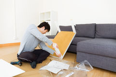 Man assembling table Stock Photography
