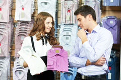 Man and assistant at apparel clothes shopping Stock Photos
