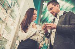 Man with assistant in jewellery shop Royalty Free Stock Photography