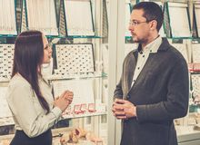 Man with assistant in jewellery shop Royalty Free Stock Image