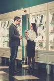 Man with assistant in jewellery shop Stock Image