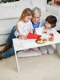 Man Assisting Children In Making Christmas Royalty Free Stock Photo