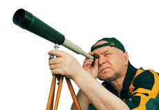 Man, an astronomer looking through a telescope. Stock Photography