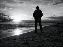 Free Man At Evening Sea. Hiker With Backpack With Hands In Pocket Along Beach. Royalty Free Stock Photo - 82751025