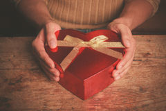 Free Man At Table With Heart Shaped Box Stock Photography - 47306362