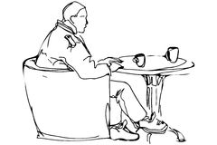 Man At The Round Table In A Cafe Drinking Coffee