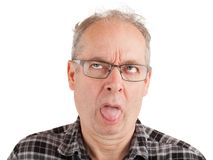 Sour Taste in the Mouth. Man ate something offensive leaving a bad taste in the mouth Royalty Free Stock Images