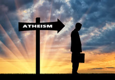 Man is an atheist in the direction where the sign shows atheism Royalty Free Stock Images