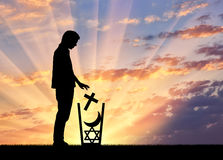 Man atheist throws all religions in the trash Stock Photography