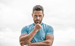 Man athlete in blue sport tshirt. sportswear fashion. muscular male with beard. thoughtful man isolated on white stock photos
