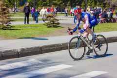 Man athlete cyclist rides on the road bike Royalty Free Stock Photos