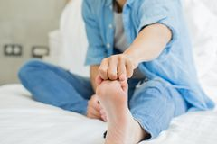 Man with athlete foot. In the room royalty free stock image