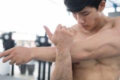 Man athlete prepare for training in gym. bodybuilder male warm u Stock Photos