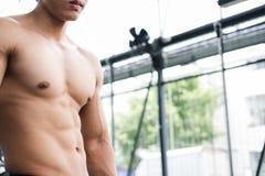 Man athlete prepare for training in gym. bodybuilder male workin Stock Photos