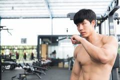 Man athlete prepare for training in gym. bodybuilder male workin Stock Image