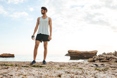 Man athlete resting after jogging at the beach Royalty Free Stock Photography