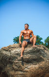 Man Athlete on a rock by the sea Royalty Free Stock Photography
