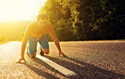 Man athlete running on the nature at sunset. Outdoors royalty free stock photos