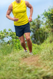Man athlete running outside on fitness trail run Stock Photo