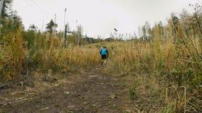 Man athlete skyrunning running uphill. Revda, Russia - September 10, 2016:  man athlete skyrunning running uphill during marathon Vertical kilometer Volchikha stock footage
