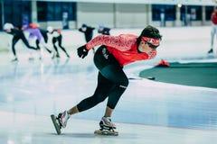 Man athlete speedskater goes around turn sprint distance Royalty Free Stock Image